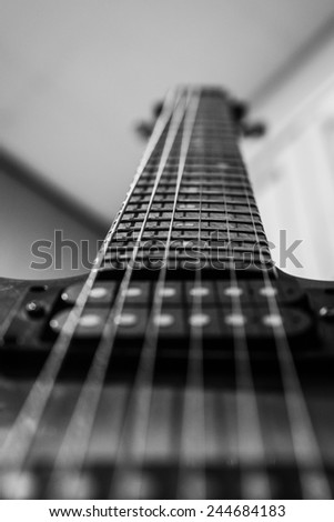 an abstract portrait of a guitar - stock photo
