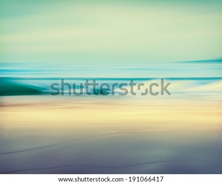 An abstract seascape made with a long exposure.  Image displays a retro, vintage look with cross-processed colors. - stock photo