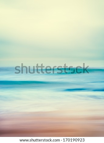 An abstract seascape with blurred panning motion and long exposure.  Image displays a retro, vintage look with cross-processed colors. - stock photo