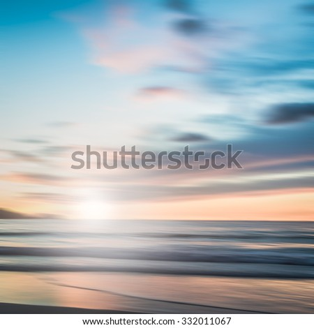 An abstract seascape with blurred panning motion with cross-processed colors background - stock photo
