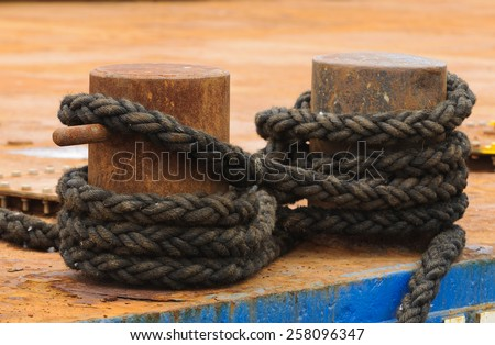 An abstract study in rope used for tieing ships to the dock in a harbor - stock photo