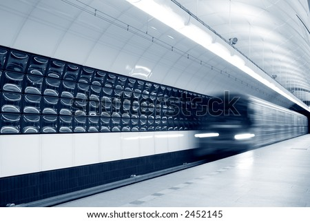 An abstract subway train blured in motion, toned - stock photo