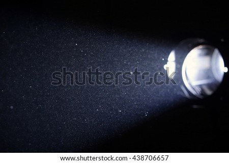 An abstract view of the illuminated dust spread out by the reflector. - stock photo