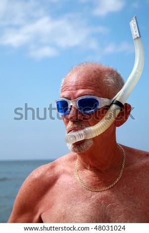 an active retired senior citizen enjoys outdoor and beach activities - stock photo