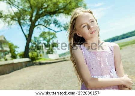 An Adorable little girl on beach vacation - stock photo