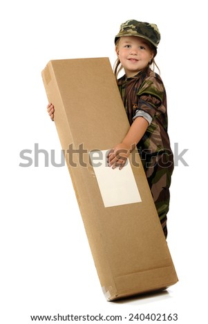 """An adorable little """"soldier"""" happily holding a big gift from home.  Isolated. - stock photo"""