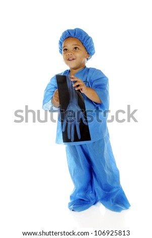 "An adorable preschool ""doctor"" happily looking up while holding an x-ray of an intact hand.  On a white background. - stock photo"