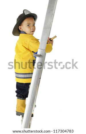 "An adorable preschool ""Fire Chief"" looking back at the viewer as he climbs a ladder with his fire hose.  On a white background. - stock photo"