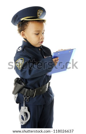 An adorable preschool police officer in full uniform writing a ticket.  On a white background. - stock photo