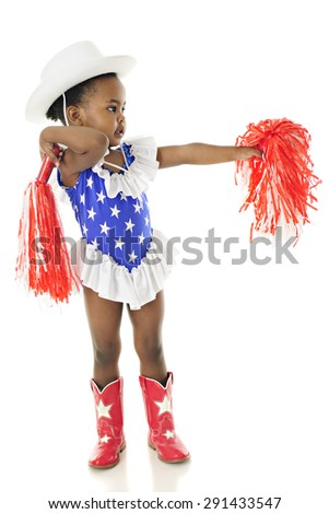 An adorable two year old in a star studded red, white and blue outfit cheering with her pom-poms for the USA.  On the white background. - stock photo