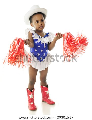 An adorable 2 year old wigging her pom-poms while in her star studded,western red, white and blue outfit.  On a white background. - stock photo