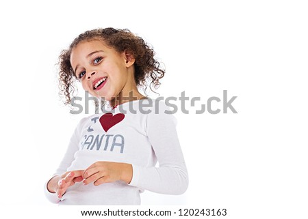 An adorable young girl wearing an I heart Santa shirt for Christmas. - stock photo