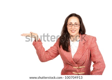 An adult businesswoman wearing a suite on a isolated white background holding a product with upturned hand - stock photo