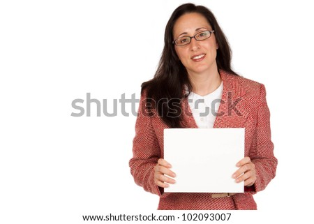 An adult businesswoman wearing a suite on a isolated white background holding a white board with room for copy - stock photo