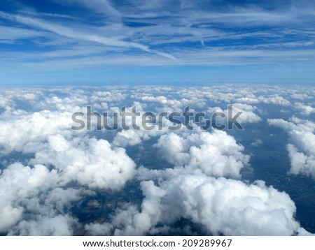 An aerial view above the clouds. - stock photo