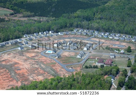 An aerial view of a new housing development. - stock photo
