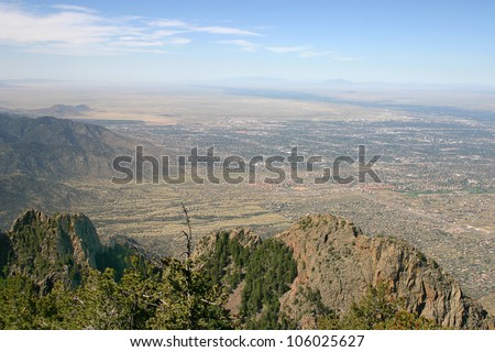 An aerial view of Albuquerque and part of the eastern mountains in New Mexico - stock photo