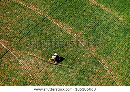 An aerial view of an agricultural crop sprayer - stock photo