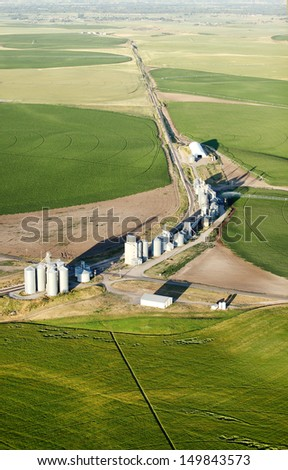 An aerial view of farmland and pivot sprinklers watering the fields. - stock photo