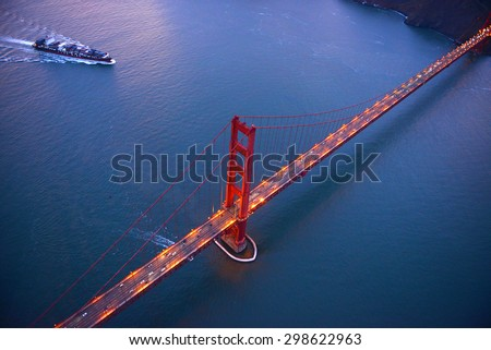 an aerial view of golden gate bridge in san francisco during sunset, taken from a helicopter - stock photo