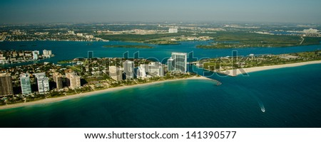 An aerial view of the seashore in Miami show deep green and blue waters. - stock photo