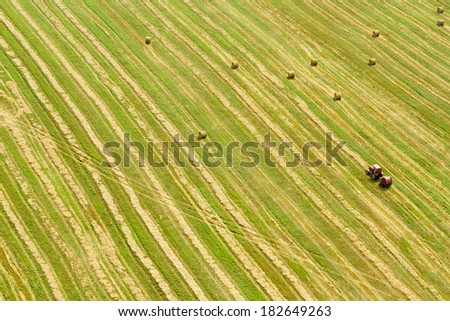 An aerial view of tractor working in a field  - stock photo
