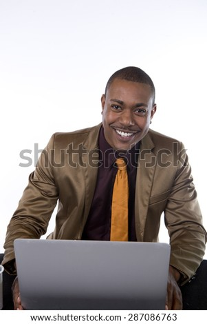 An African American business man with is laptop, smiling - stock photo
