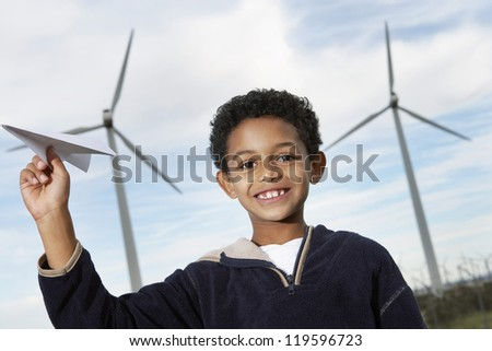 An African American cute little boy playing with paper plane - stock photo
