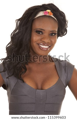 An African American in her gray top and head band smiling. - stock photo