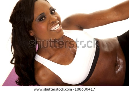 An African American with a smile on her face working out. - stock photo