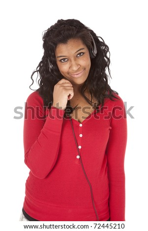 An African American woman has a headset on. - stock photo