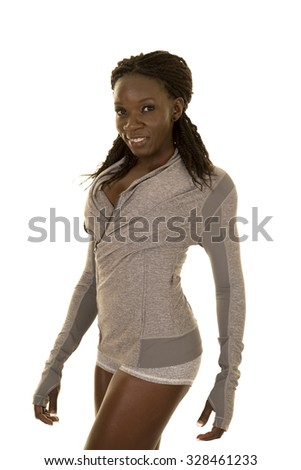 An African American woman in her fitness clothing with a smile. - stock photo