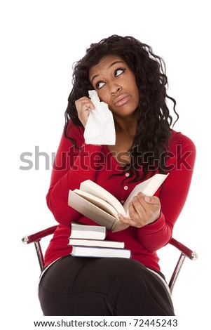 An African American woman is reading and is sad. - stock photo