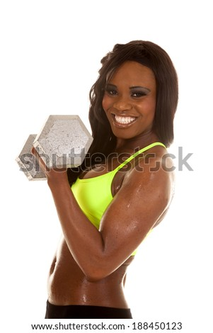 an African American working out with weights, getting fit. - stock photo