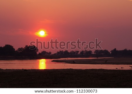 An African Sunset on the Luangwa river, South Luangwa Valley, Zambia - stock photo