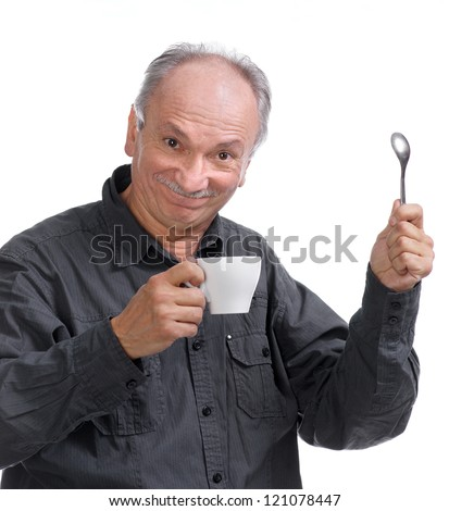 An aged cheerful old man holding a cup of coffee and smiling on white background - stock photo