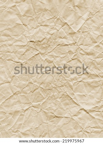 An aged looking tea-stained, crumpled paper texture. - stock photo