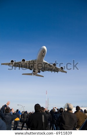 An Airbus A380 on final approach near Montreal Airport. - stock photo