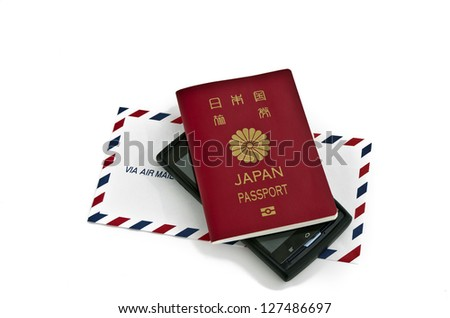 an airmail envelope and a passport and a smartphone on white - stock photo