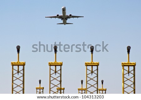 An airplane is taking off from an airport - stock photo