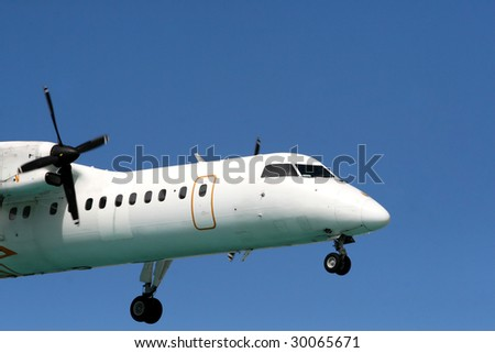 An Airplane which is going to land on St maarten airport (TNCM) - stock photo