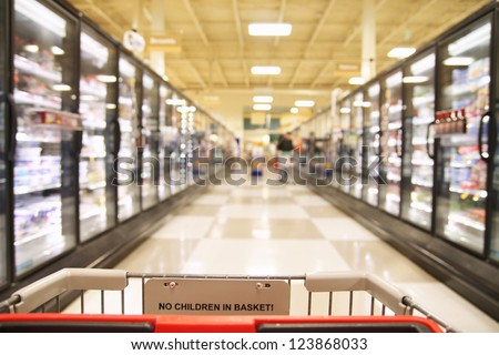 an aisle in a grocery store showing frozen foods - stock photo