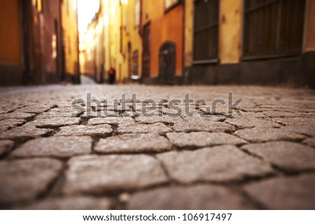 An alley in the Old Town, Stockholm, Sweden. - stock photo