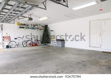 An almost empty garage to be used as storage for junk that will be collected over the years - stock photo