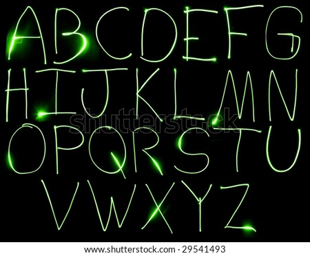 An alphabet set made from motion blurred light. - stock photo