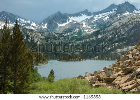 An alpine lake in the Eastern Sierra Nevada Mountains. - stock photo