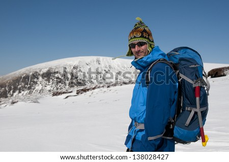 An alpinist in Wicklow mountains in Ireland, Winter climbing - stock photo