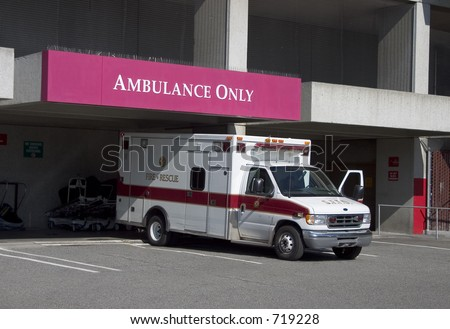 An ambulance has arrived at the hospitals emergency room. - stock photo