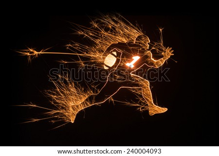An American football player in sparkly design on black background. - stock photo