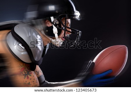 An American football player is participating in a game - stock photo